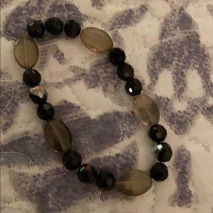 Black stretchy bracelet with clear stones.
